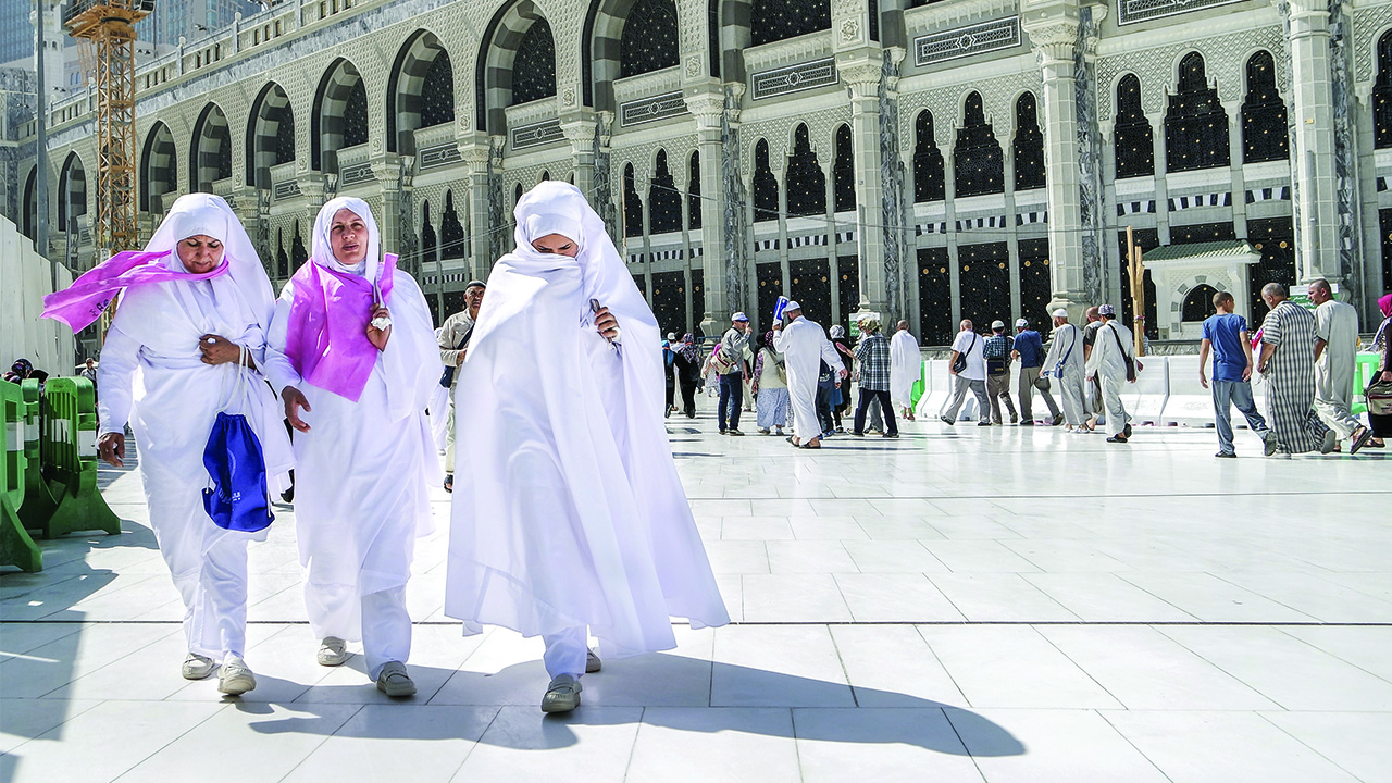 Women in Saudi Arabia walk through city.