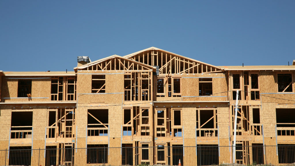 Photo of apartments being built.
