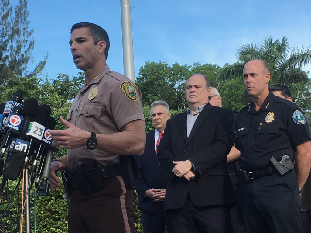 Miami-Dade Police Director Juan Perez speaks with reporters