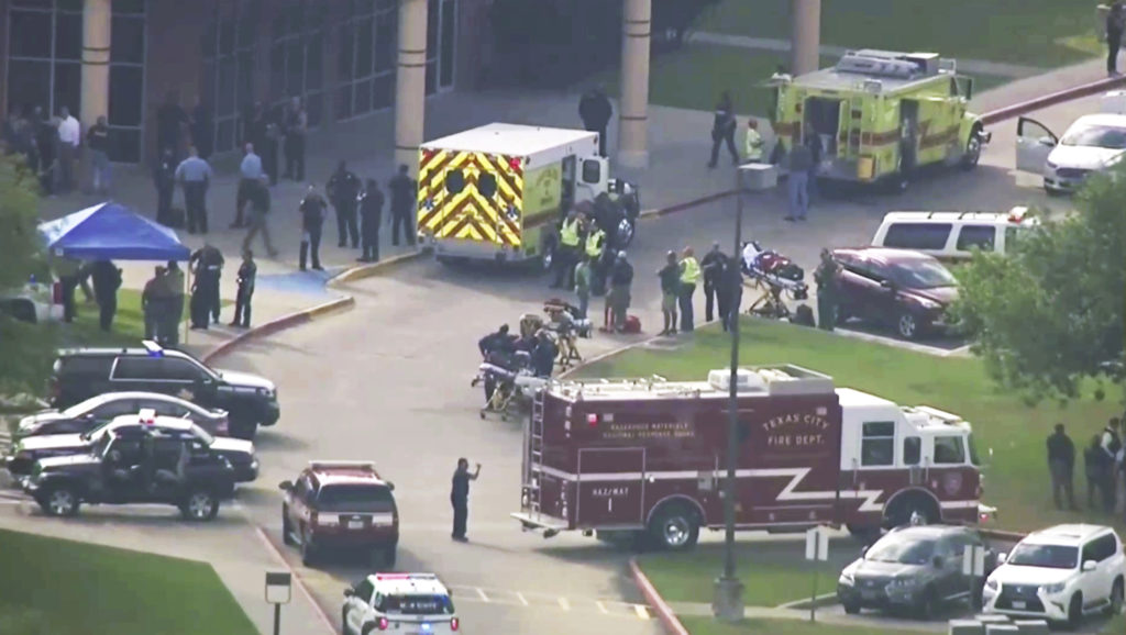 Emergency personnel and law enforcement officers respond to a high school near Houston after an active shooter was reported on campus