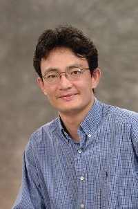 Portrait of UCLA professor Yufeng Lu, who is researching a cure for hangovers.