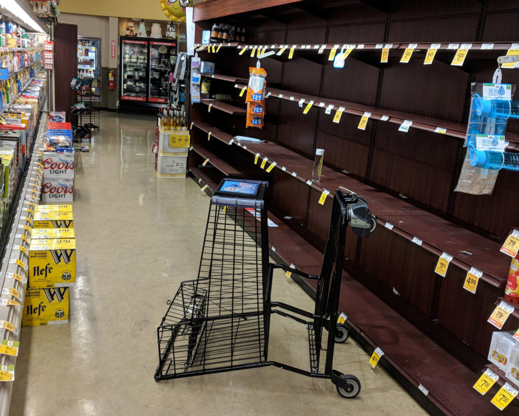 Photo of empty shelves in Salem, Oregon, after shoppers bought out all the bottled water