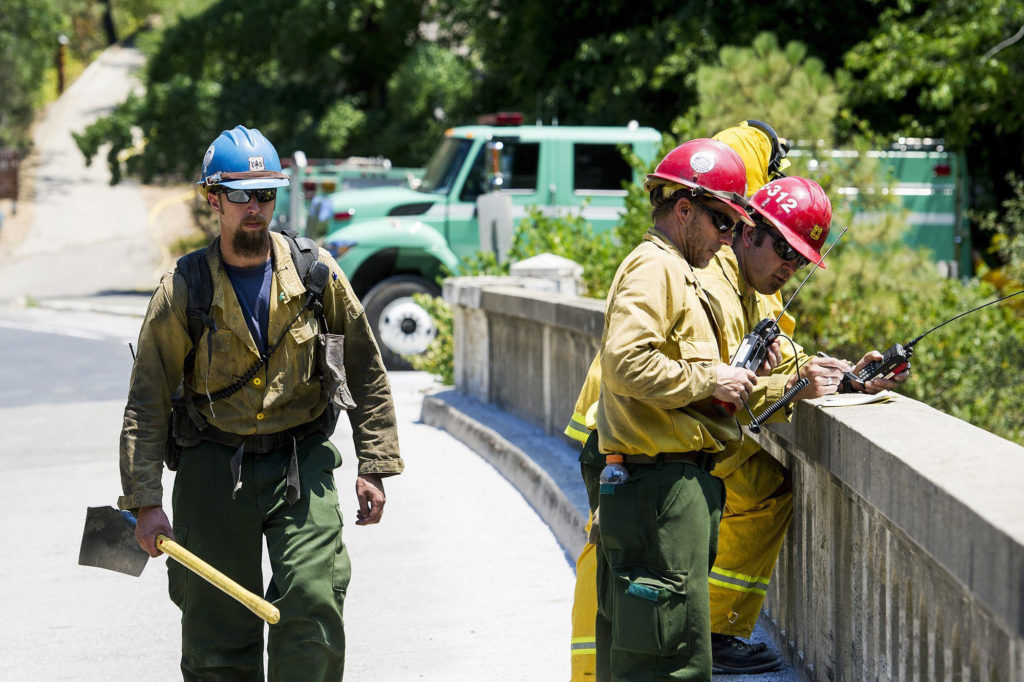 Photo of firefighters on Merced River bridge