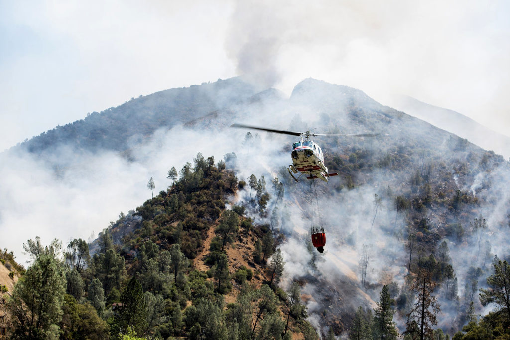 Photo of helicopters battling the Ferguson Fire