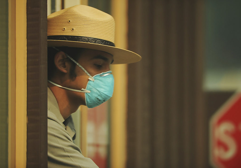 Photo of park ranger wearing mask because of bad air quality
