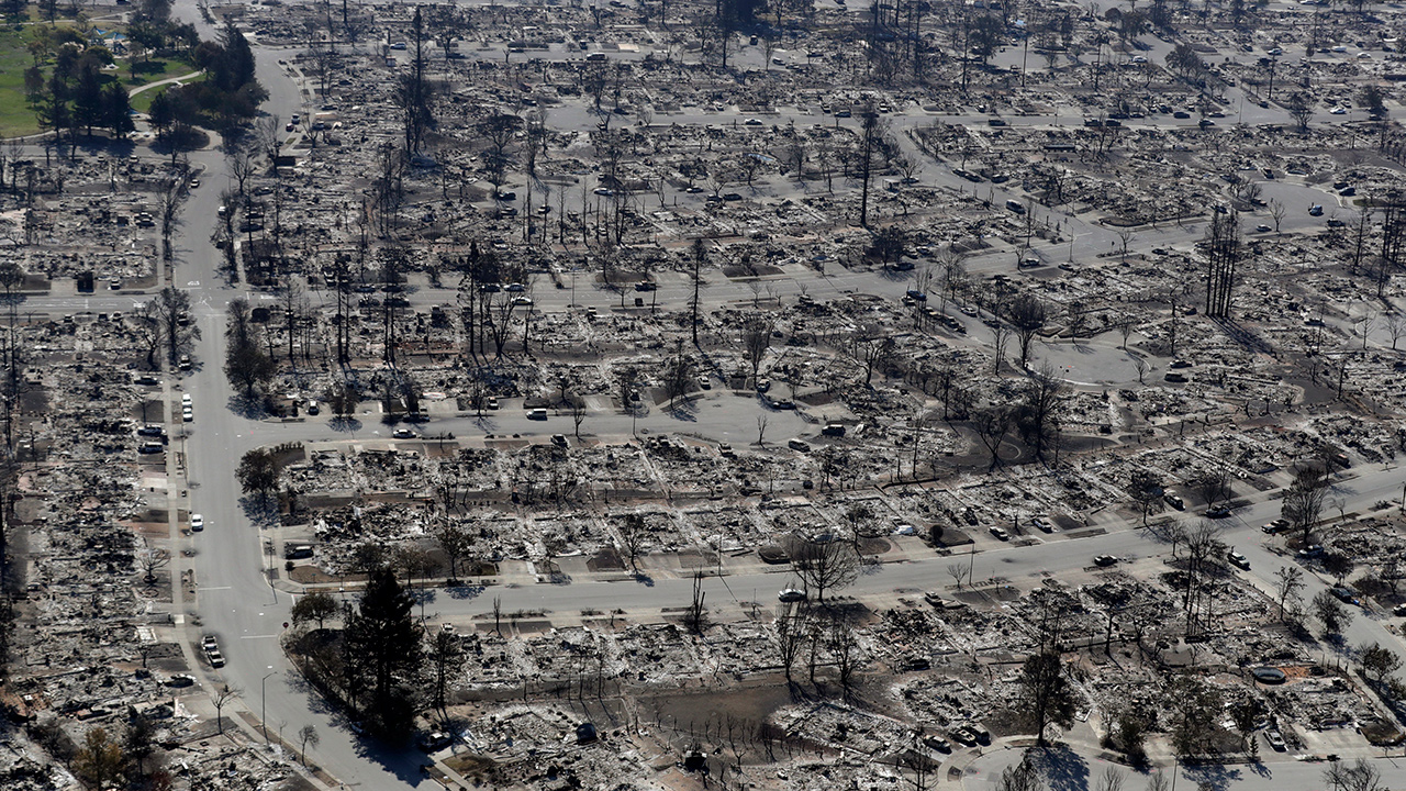 An aerial view shows the devastation of the Coffey Park neighborhood ...