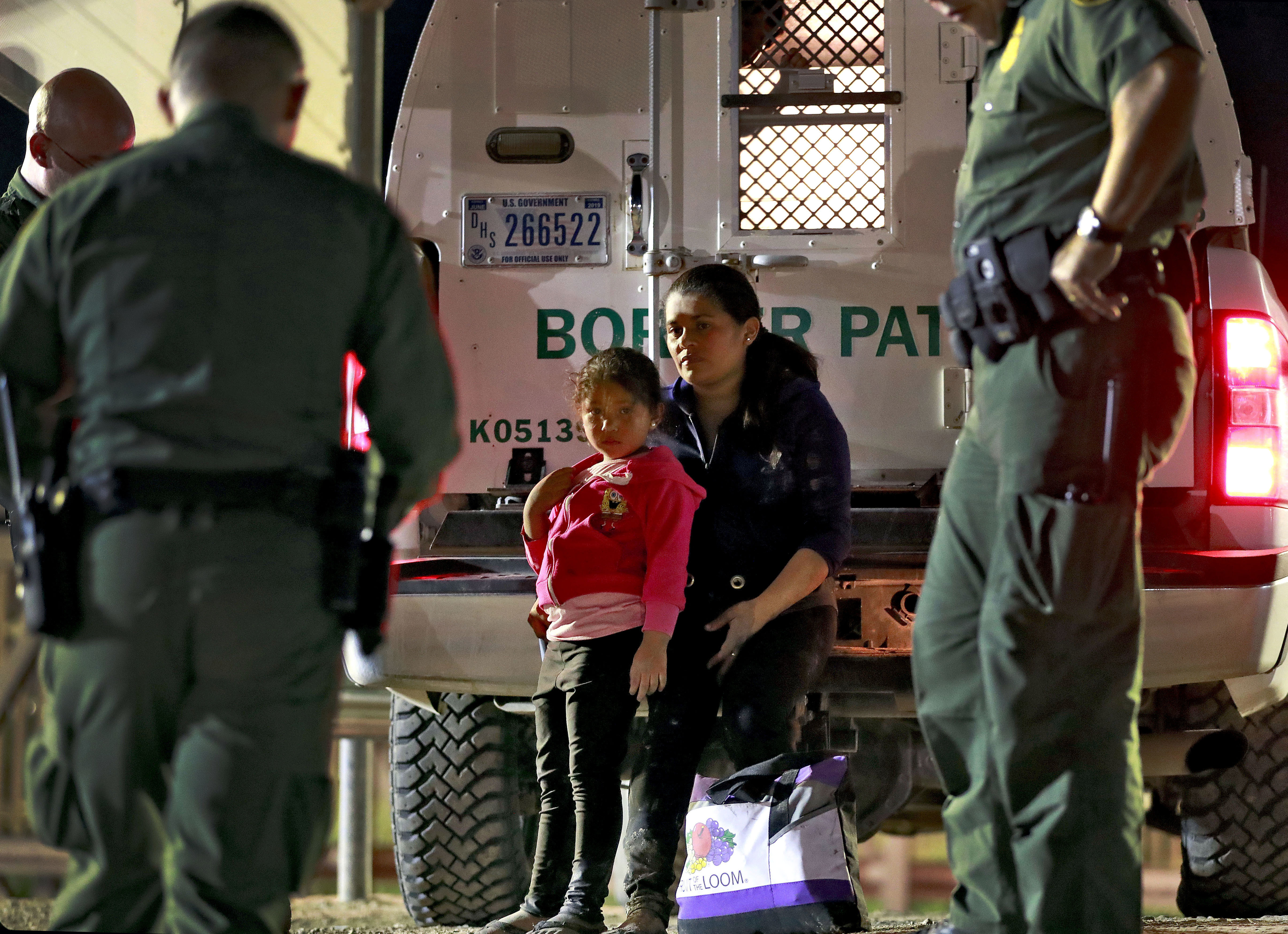 Photo of mother and daughter from Honduras detained at the U.S. border.