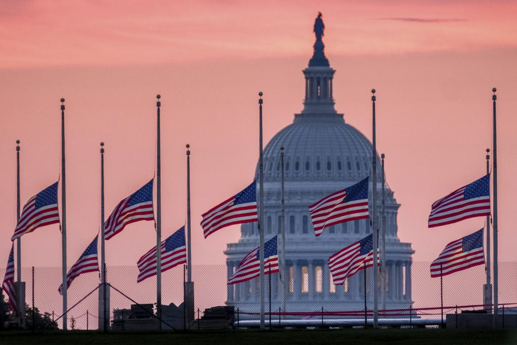 Photo of flags at half staff for Sen. John McCain