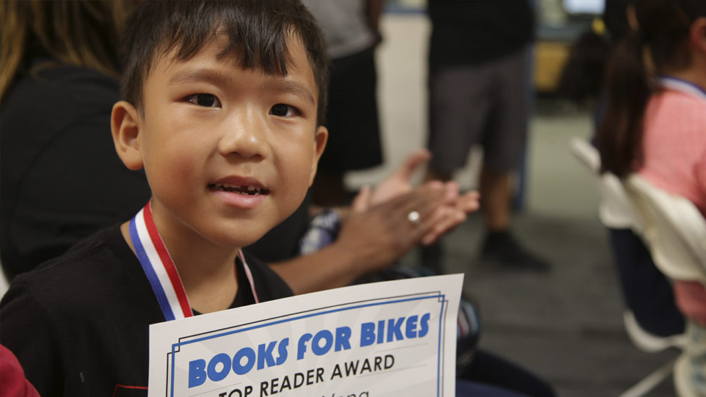 Johnny Yang holds his Top Reader award