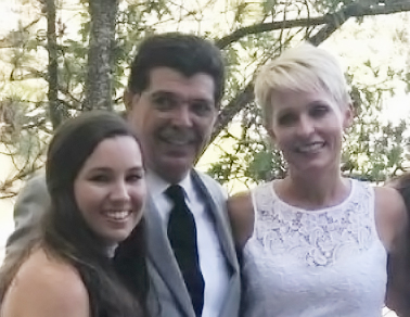 Mollie Tibbetts, left, with her father Rob and step-mother Kacey