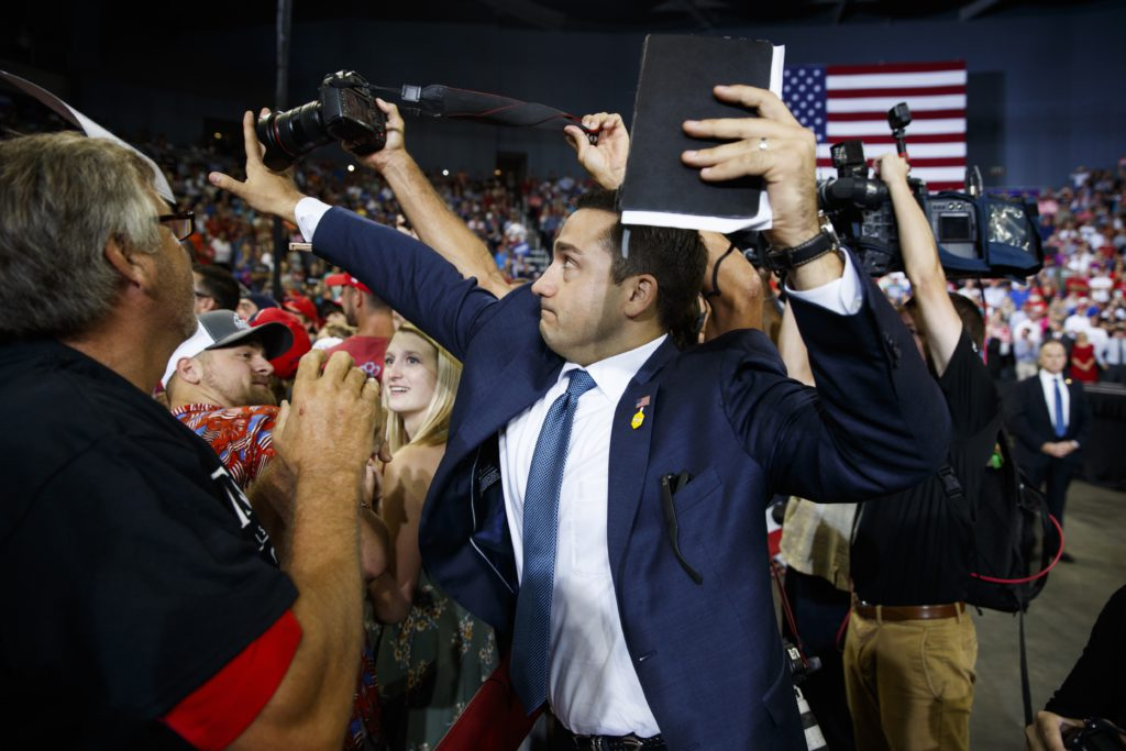 Photo of Trump volunteer blocking a camera