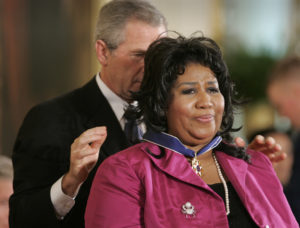 Photo of President George W. Bush giving Aretha Franklin the presidential medal