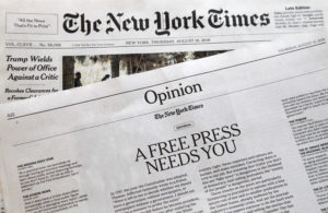 Photo of editorials from New York Times and Boston Glove