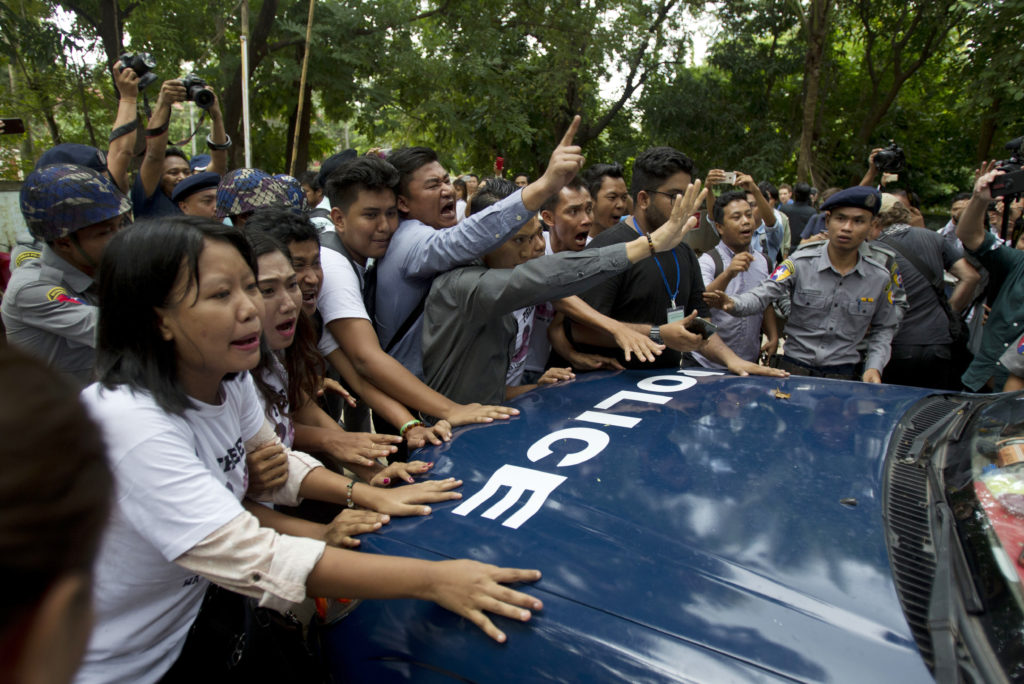 Photo of protesters following sentencing of Reuters journalists in Myanmar