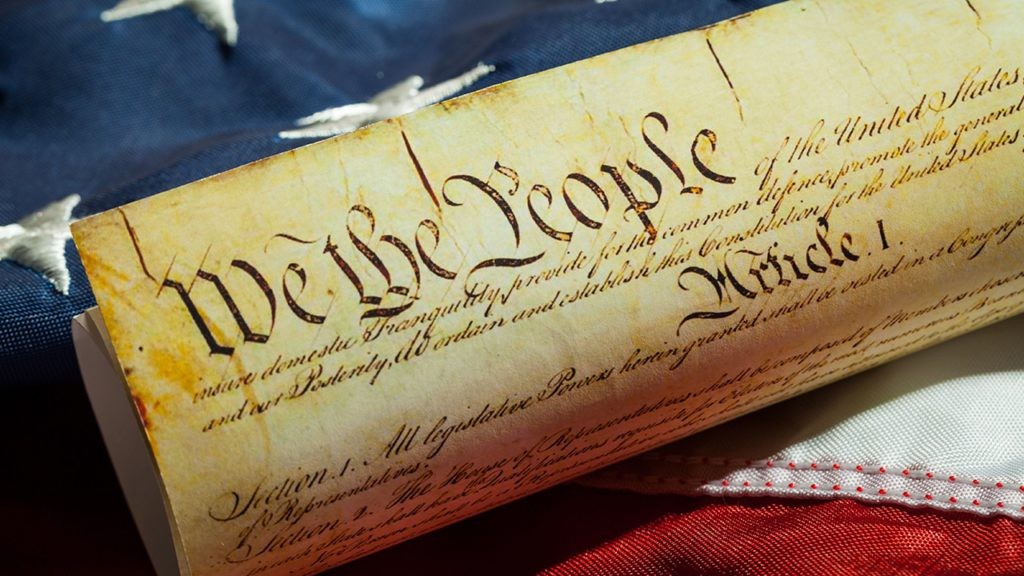 Photo of U.S. Constitution and American flag
