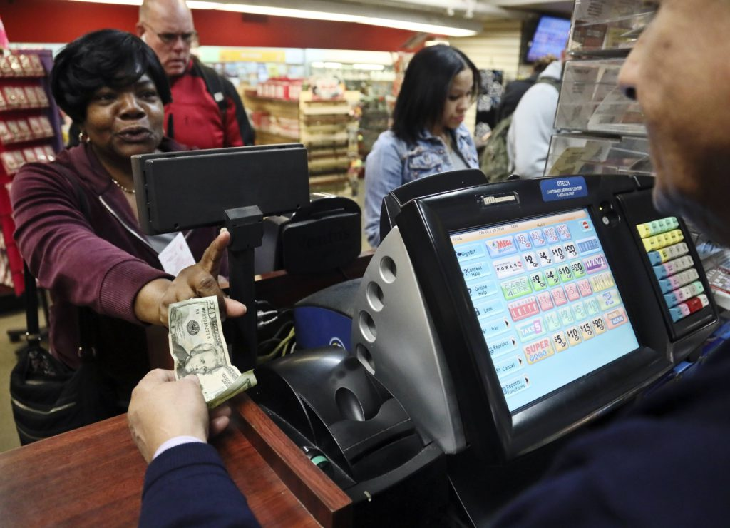 Photo of woman buying a Mega Millions lottery ticket in New York
