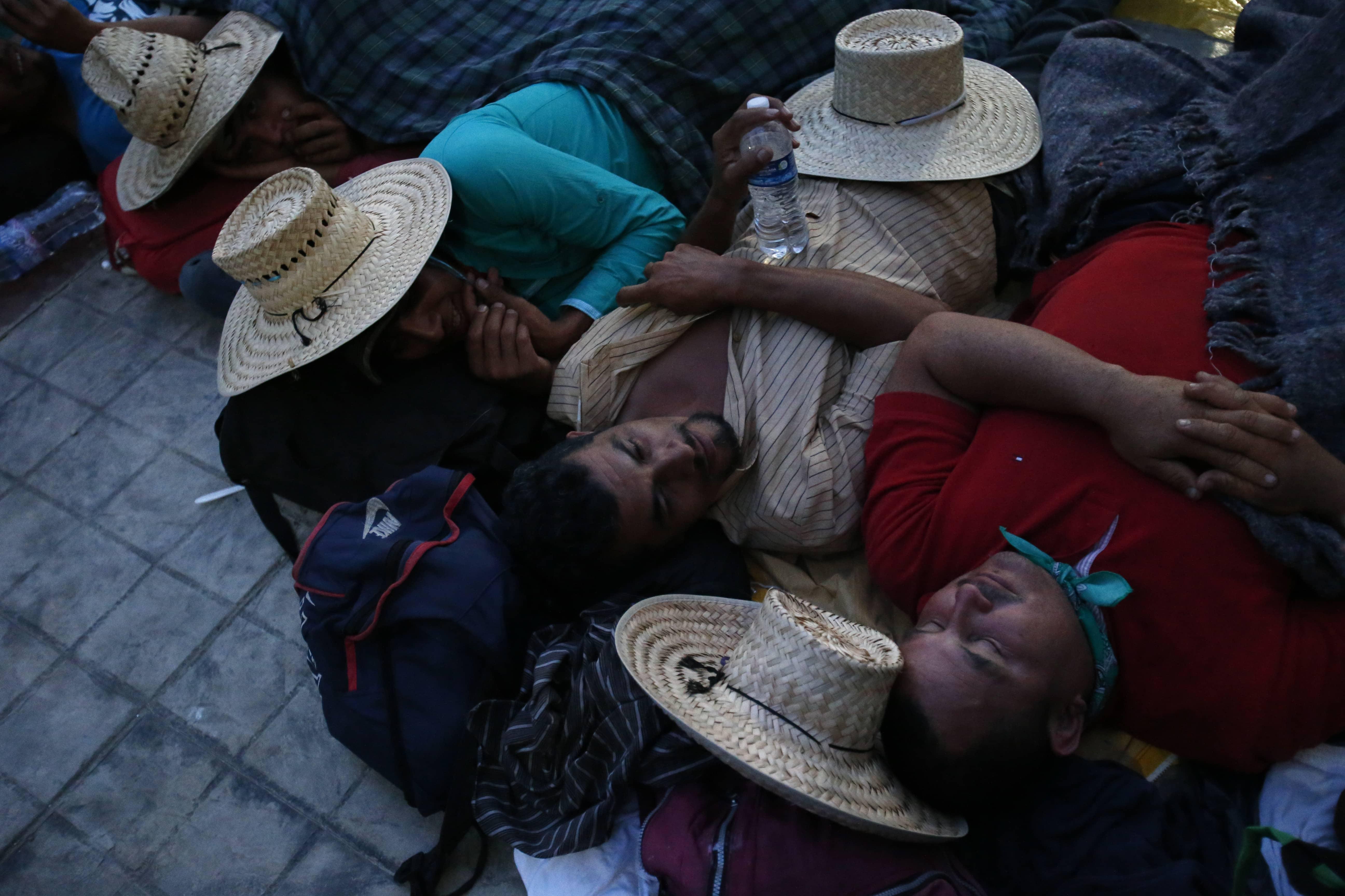 Photo of migrants sleeping in a church courtyard at nightfall