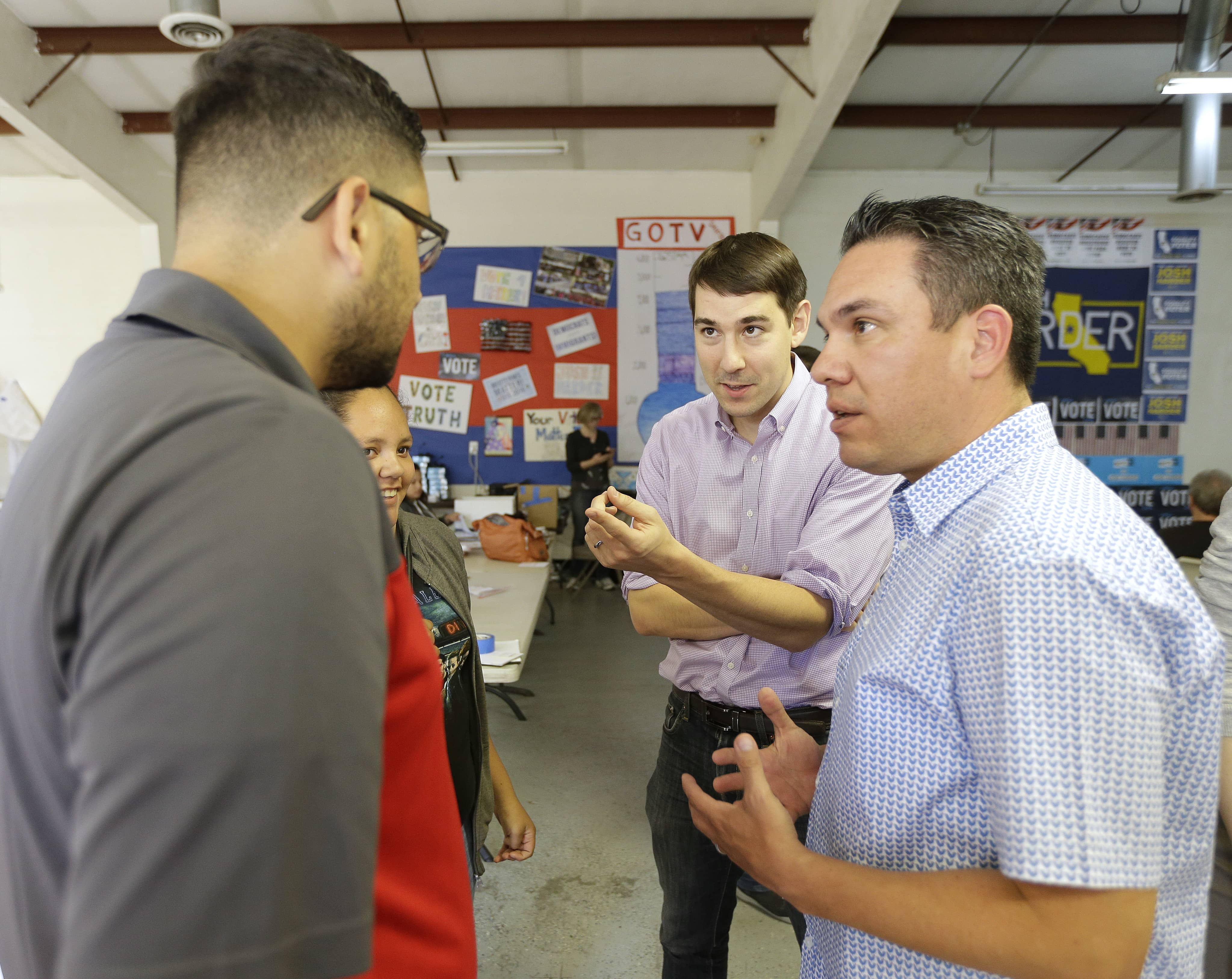 Photo of Josh Harder talking with supporters