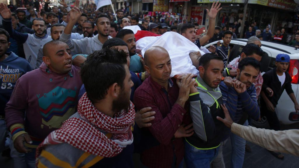 Photo of Palestinian mourners carrying the body of a dead compatriot