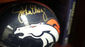 Photo of a Denver Broncos helmet signed John Elway
