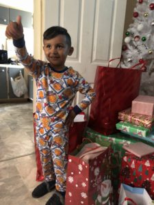 Photo of a boy in Mendota, CA, giving a thumbs up for his Christmas gifts