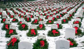 Photo of wreaths in snow at Arlington National Cemetery