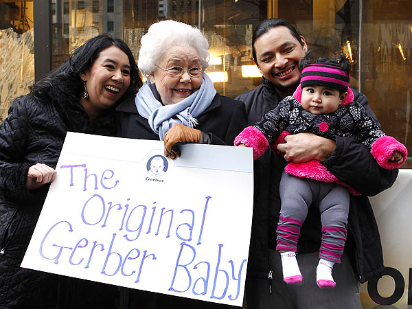 Photo of the Montoya family with the original Gerber baby, Ann Turner Clark