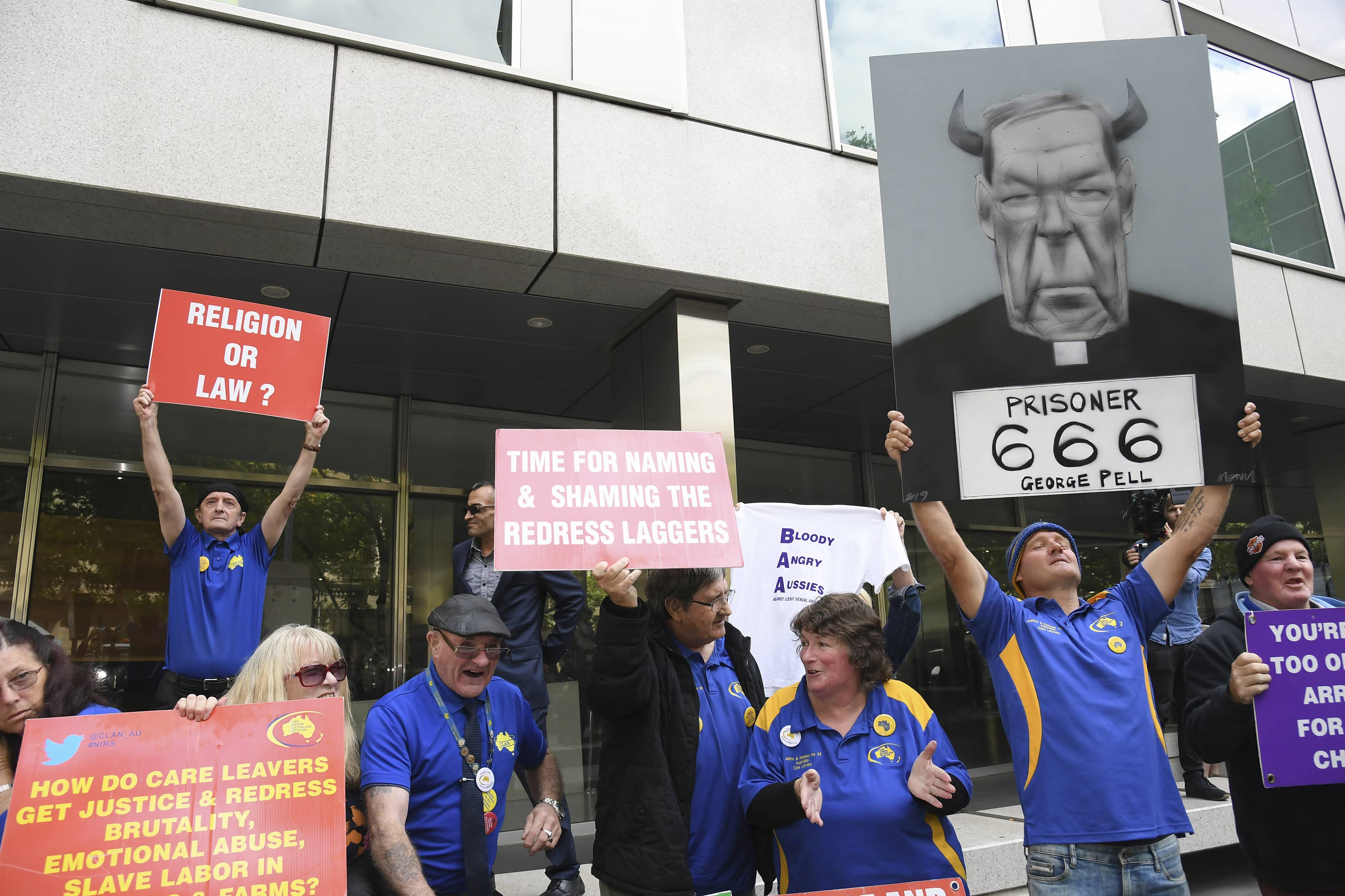 Photo of protestors during the sentence of Cardinal George Pell