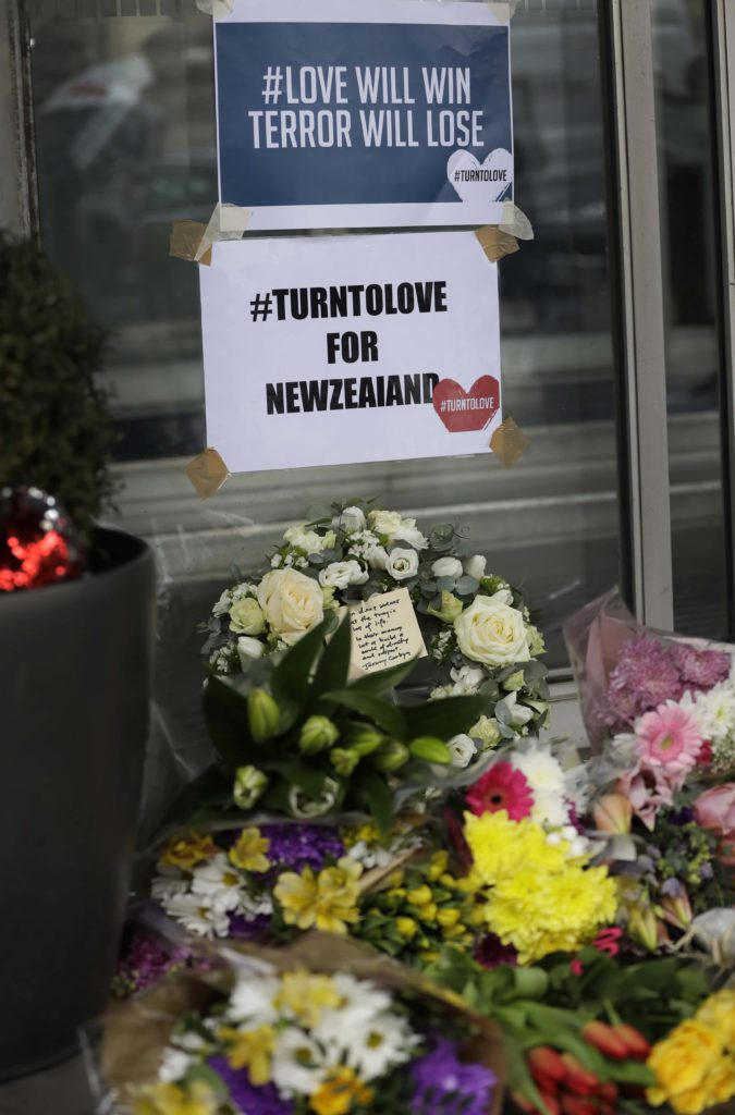 Flowers honoring the victims of the mosque attack in New Zealand