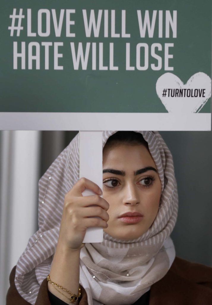 Photo of woman at a London vigil for mosque attack in New Zealand