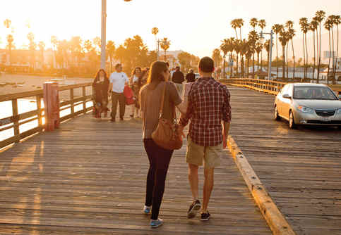 Photo of a couple walking on Santa Barbara pier.