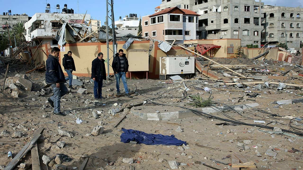 Photos of Palestinians inspecting the damage in Gaza City