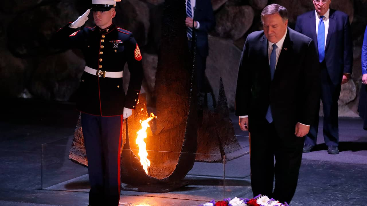 Photo of Mike Pompeo taking part in a wreath laying ceremony
