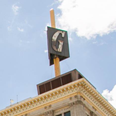 Picture of iconic 'G' sign on top of Guarantee Building in downtown Fresno