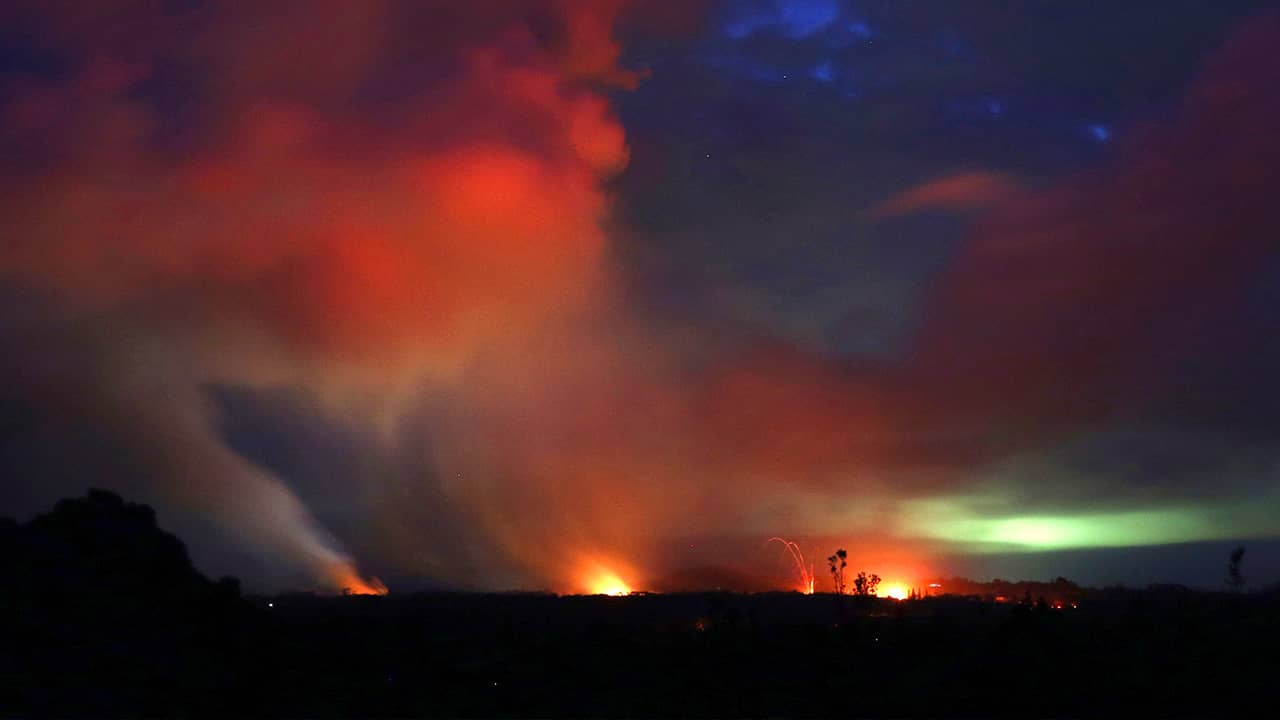 Photo of lava shooting into the night sky in Pahoa, HI