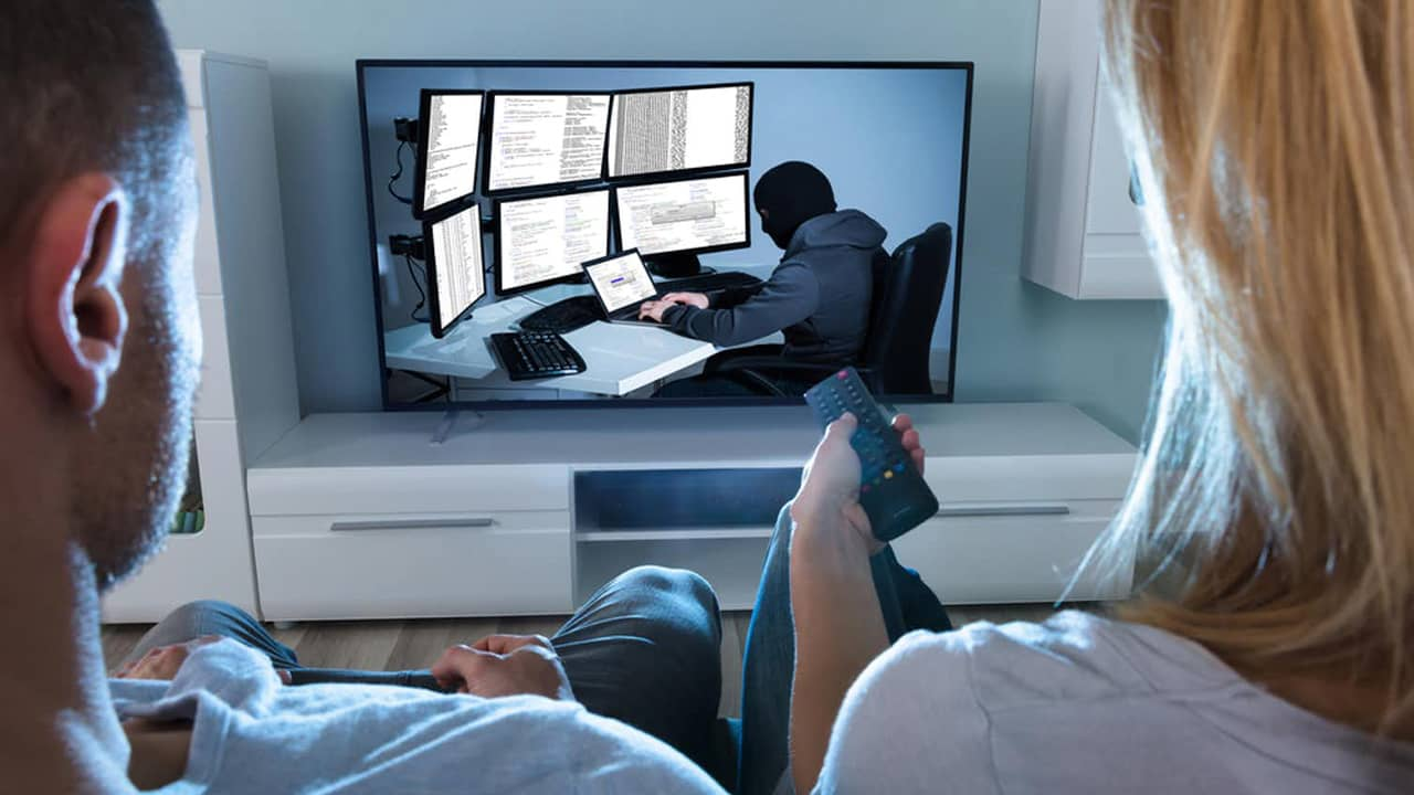 Photo of people watching tv.
