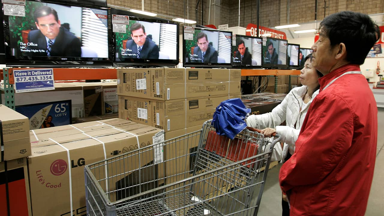 Photo of people at Costco watching The Office on the TVs