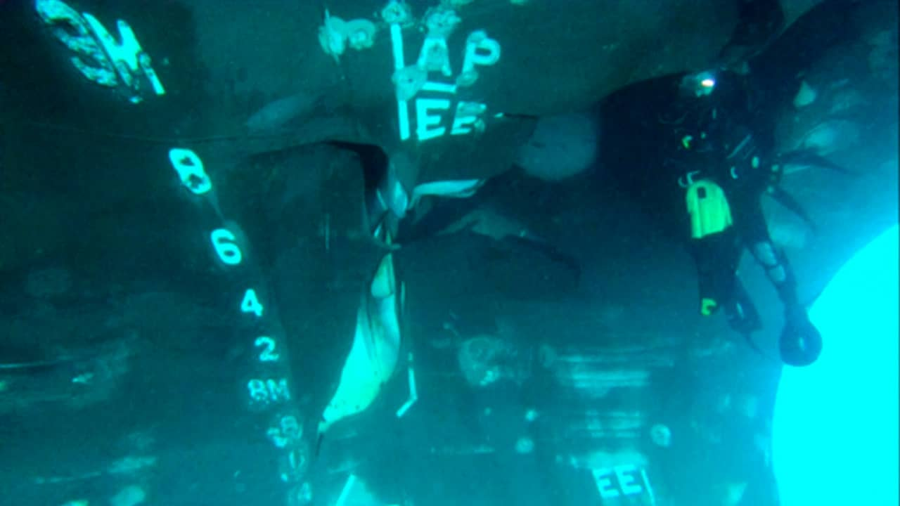 Photo of a diver investigating the damage done to the Saudi-owned oil tanker
