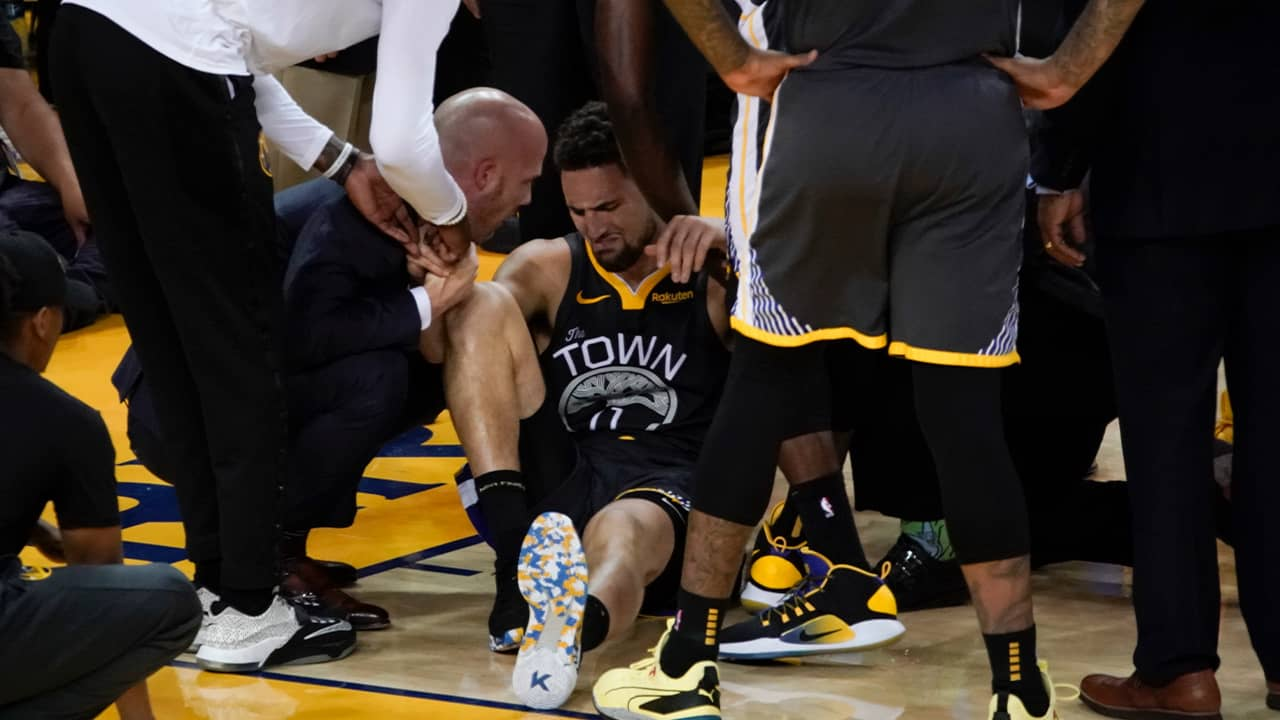 Photo of Klay Thompson being helped up after being injured