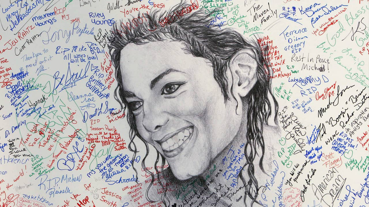 Photo of signatures on a poster of Michael Jackson