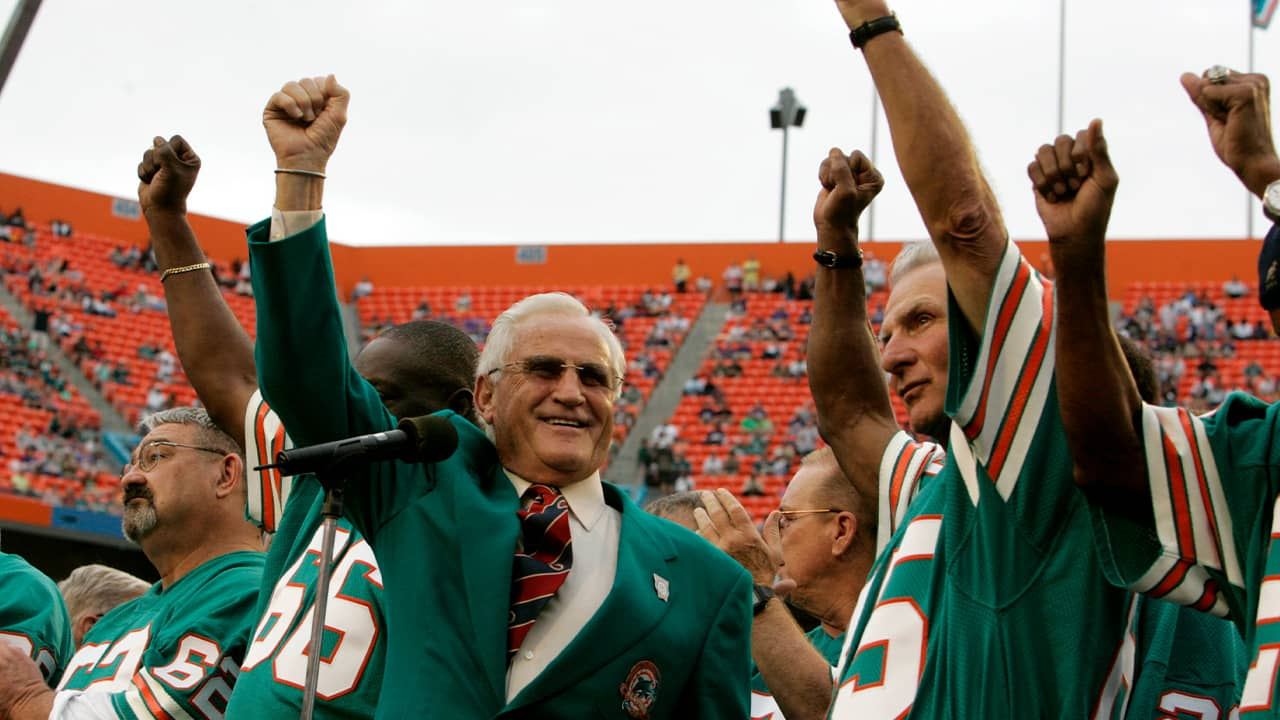 Former Miami Dolphins coach Don Shula, left, and player Nick Buoniconti, right, wave during a halftime ceremony
