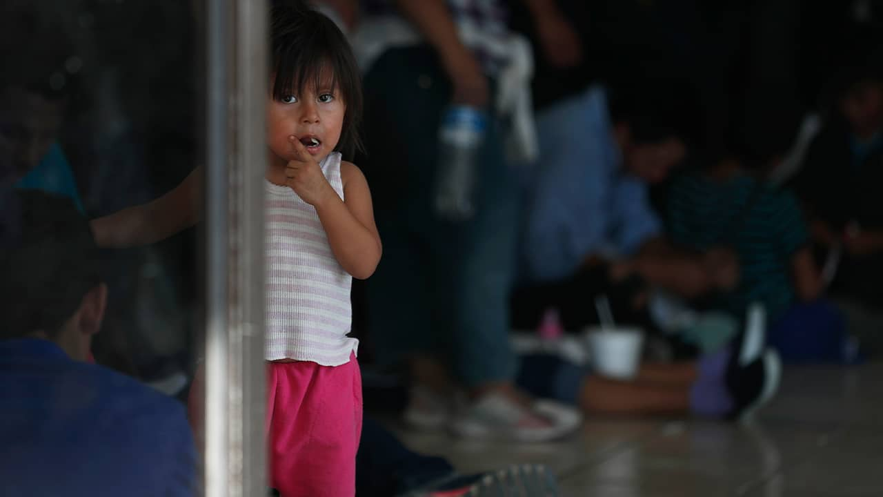 Photo of migrant child at an immigration center