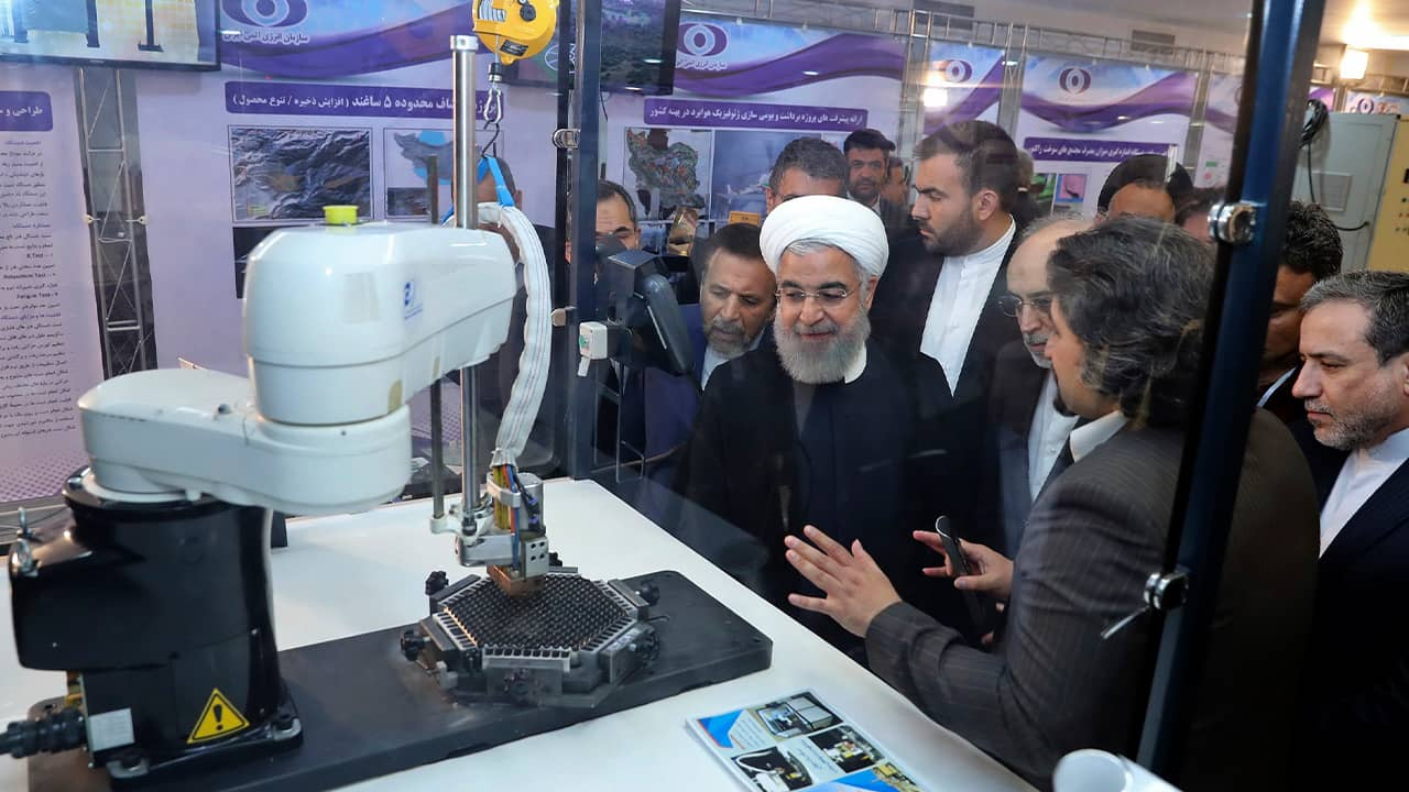 Photo of President Hassan Rouhani listening to explanations on nuclear achievements