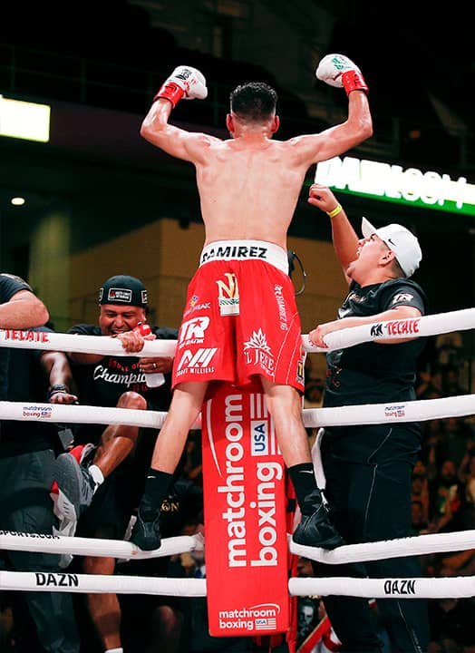 Photo of Jose Ramirez celebrating TKO victory over Maurice Hooker