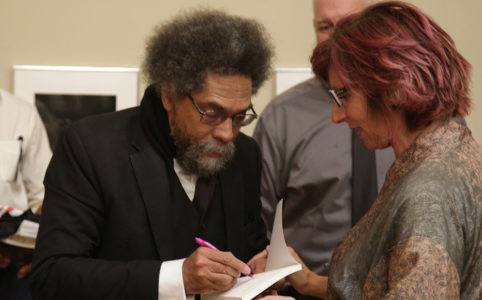 Cornel West signs autographs after a speech at Fresno City College on Aug. 27, 2019 (GV Wire/Jahz Tello)
