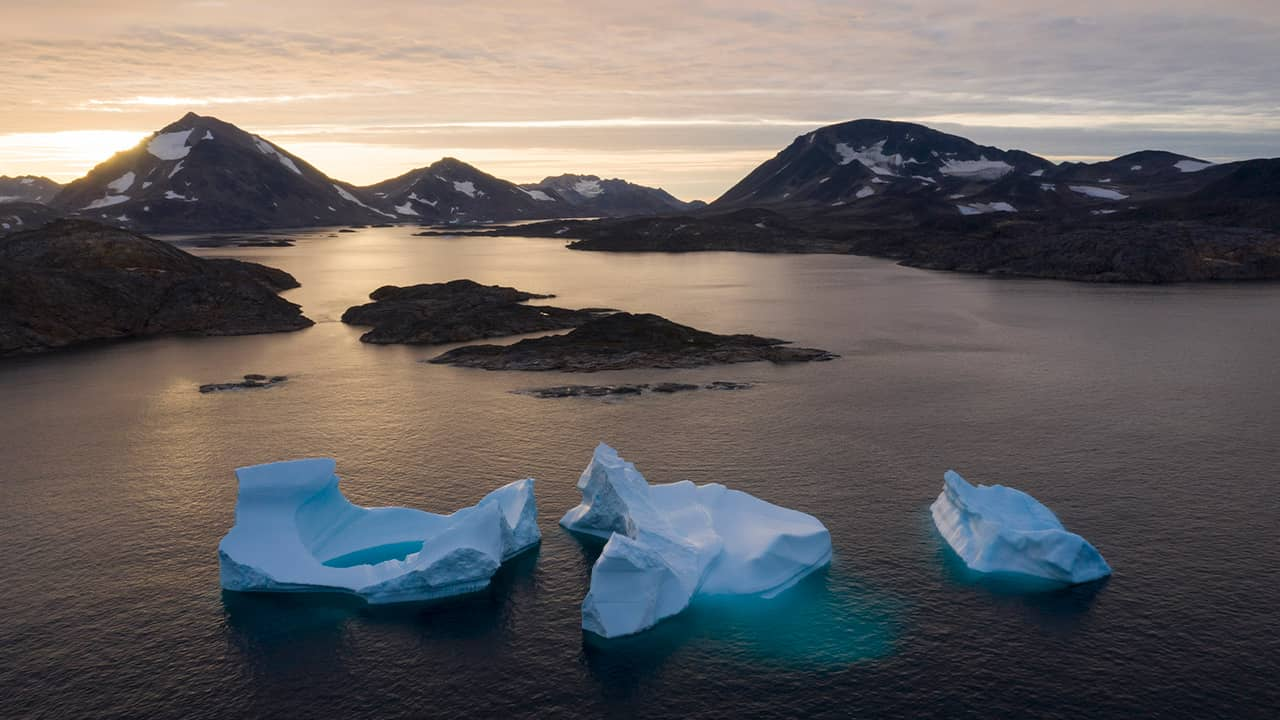 Photo of large icebergs floating in Greenland