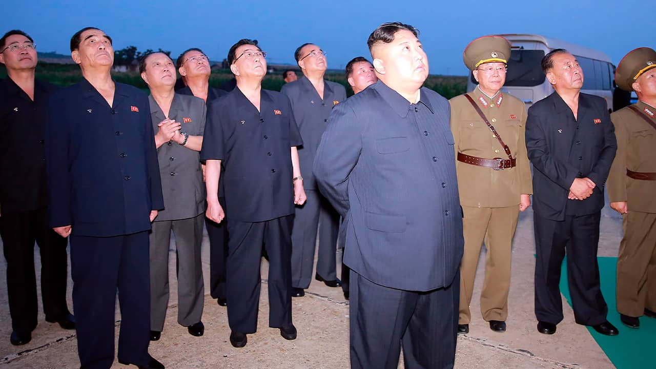 Photo of Kim Jong Un watching weapons demonstrations