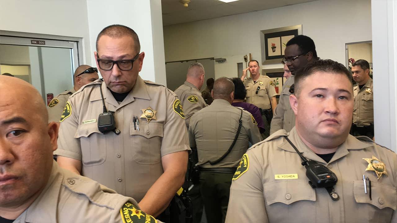 Photo of sheriff deputies escorting Martha Valladarez away