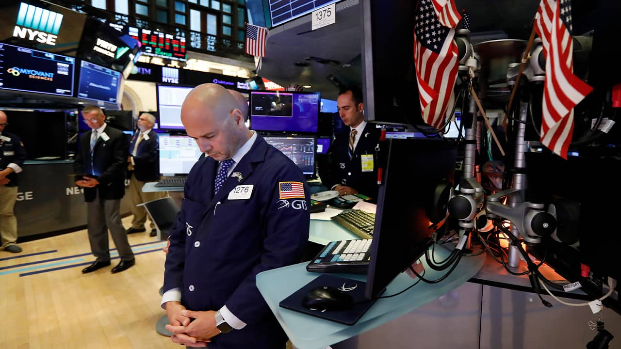 Photo of NYSE traders taking a moment of silence for the weekend's mass shootings