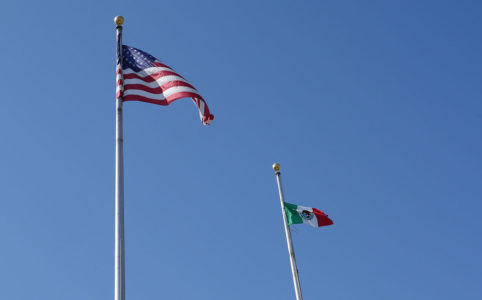 The American and Mexican flag fly at Fresno City Hall (GV Wire/Jahz Tello)
